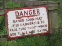 Danger sign at the edge of a rifle range