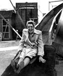 Image of a 1940s woman on a fairground slide