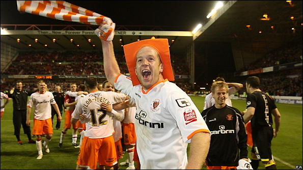 Blackpool midfielder Charlie Adam celebrates the win over Nottingham Forest.