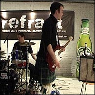 Guitarist, Charlie Milne in his kilt at An Evening of Scottish-ness