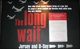 Sign showing aircraft  which reads: The Long Wait Jerey and D-Day