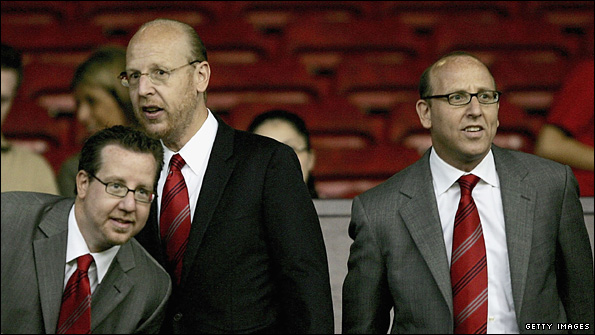 Bryan Glazer and his brothers Avram and Joel at Old Trafford