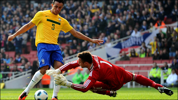 Brazil's Leandro Damiao has an effort stopped by Scotland goalkeeper Allan McGregor of Scotland