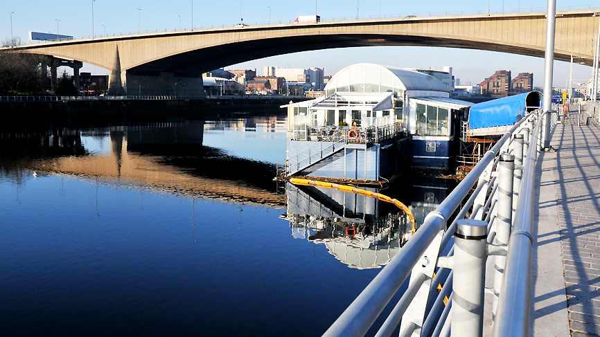 View of the Renfrew Ferry underneath the Kingston Bridge over the River Clyde, Glasgow.