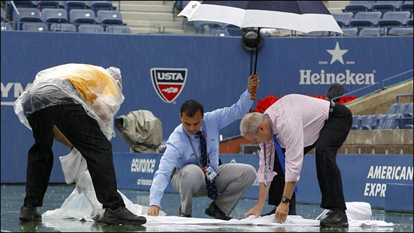 Officials attempt to make the playing surface safe