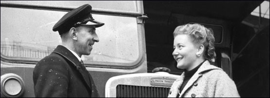 A woman and a bus driver in conversation
