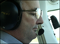 Roger Keen piloting his plane