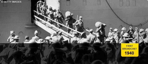 Allied troops disembark from ship.