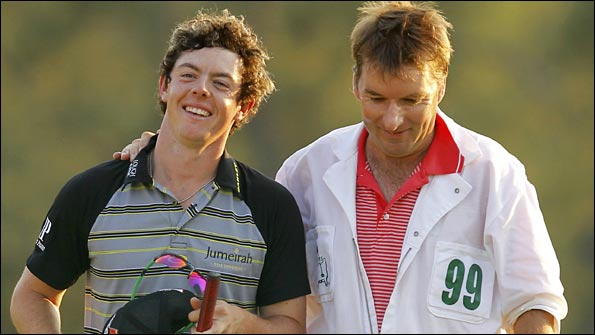 McIlroy raises a smile as he walks off the 18th green with his caddie