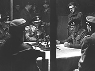 4 May 1945: Field Marshal Sir Bernard Montgomery signs the surrender of German armies in the north