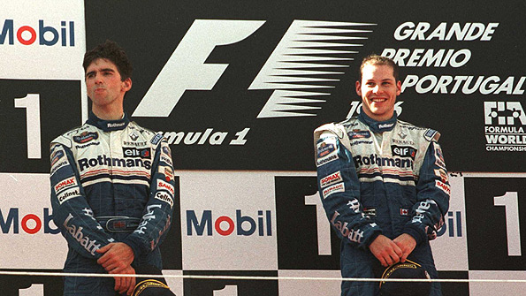Damon Hill (left) and Jacques Villeneuve on the podium at the 1996 Portuguese Grand Prix