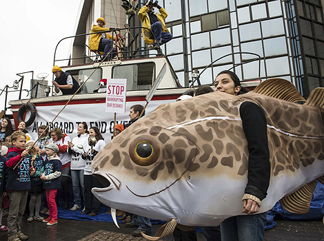 Woman dressed as a fish on a WWF demonstration in Brussels