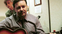 David Brent playing the guitar