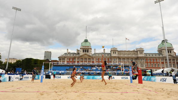 Olympic test events such as the Beach Volleyball International tournament at Horse Guards Parade are going ahead despite the rioting in London. Photo: AP