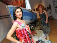 Esen Kaya and Ingrid Wagner by a boat covered in knitting. Photo: Craig Leng Photography