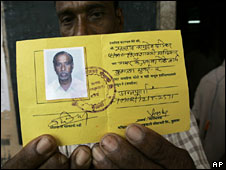 Indian fisherman with his local ID card