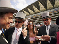 Race-goers celebrate a win at Royal Ascot
