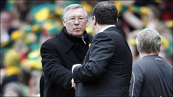 Sir Alex Ferguson (facing camera) and Rafa Benitez shake hands at the end of the match
