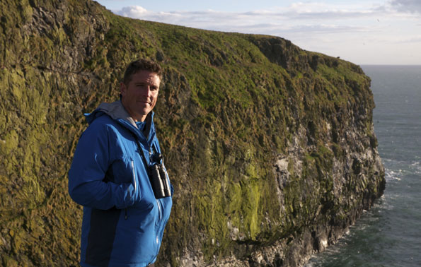 Iolo Williams by cliffs by Dan Rees