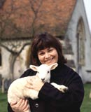 Dawn French as the Vicar of Dibley, holding a lamb