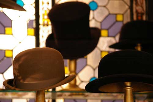 Bowler hat and top hat on stands