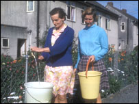 Women using a stand pipe in the drought of 1976