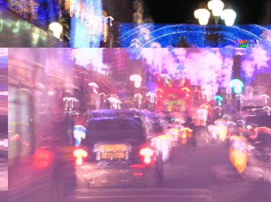 Christmas lights in Regent Street, with traditional black London taxis and red buses.