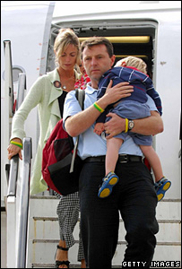 McCann family emerging from aeroplane