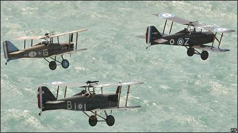 Three replica World War I SE5A fighter aircraft fly in formation over the sea off Brighton, England, Thursday July 30, 2009, after the funeral of World War I veteran Henry Allingham
