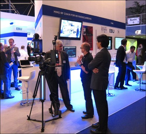 Members of the halfRF team demo the technology on the EBU stand at IBC