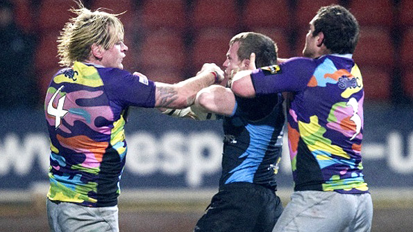 Edinburgh's Scott MacLeod and Glasgow's Chris Fusaro exchange blows in the first leg of the 1872 Cup. Photo: SNS