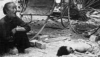A Chinese grandmother mourns her grandchild after a Japanese bombing raid on Singapore
