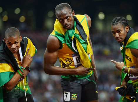 Usain Bolt celebrates with Jamaica's Yohan Blake and Warren Weir after the men's 200m final.