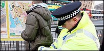 Police officer conducts stop and search