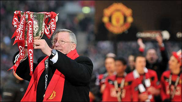 Sir Alex Ferguson holds the Carling Cup