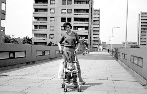 Mother pushes pram in Thamesmead, 1977