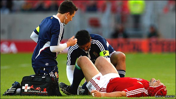 Lions forward Euan Murray receives treatment during the Kings match