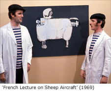 John Cleese and Michael Palin in the sketch 'French Lecture on Sheep Aircraft' taken from Monty Python's Flying Circus Series 1, Episode 2 - Sex and Violence (recorded 30 August 1969; aired 12 October 1969)