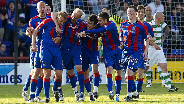 Inverness players celebrate after scoring a goal against Celtic