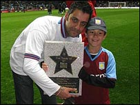 Phil & James Upton with star