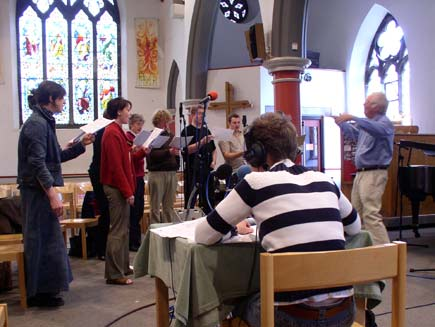 Clair Jaquiss, Nigel Swinford conducting the Daily Service Singers, the organ and a technician - ready for broadcast