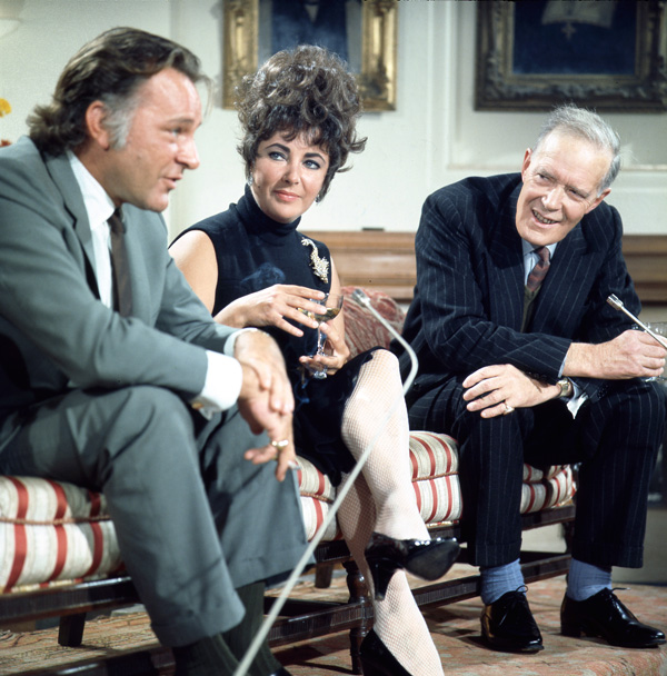 Richard Burton, Elizabeth Taylor and Neil Coghill filming an interview at Merton College, Oxford in 1967.