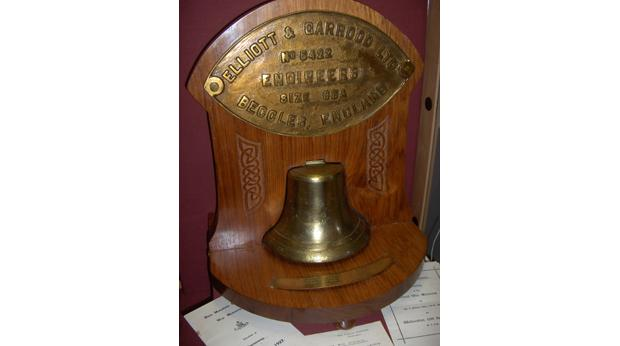 The Bell & Engine Plate from the HM Yacht Iolaire. Copyright Museum nan Eilean.