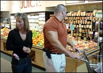 Nik Clark and Kim Garny shopping