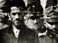 Photograph showing Gavrilo Princip, on trial for the murder of Archduke Franz Ferdinand and his wife arriving at court.