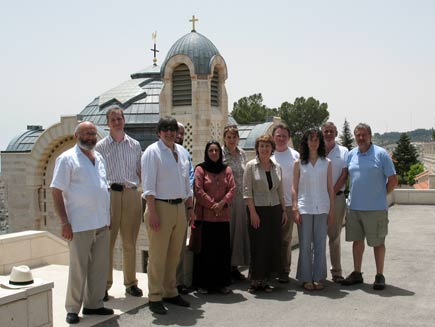 Daily Service contributors standing in front of sunlit church domes.  Left to right: Rabbi Dr Alan Unterman, Philip Billson, Dr Ed Kessler, Dr Musharraf Hussain, Anjum Anwar, Becky Harris, Christine Morgan, Canon Chris Chivers, Charlotte Kirby, Ernie Rea and Phil Booth