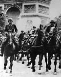Photograph of German troops riding horses down the Champs D'Elysee in Paris