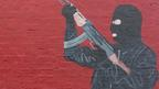 Mural of a paramilitary gunman (Pacemaker Press Intl)