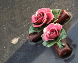 Ceramic grave ornament, a cross with roses