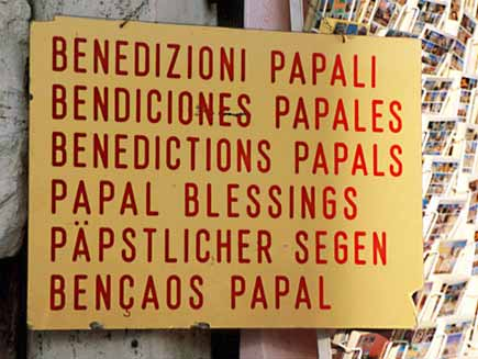 A notice advertises 'Papal blessings' in several languages